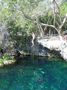 Cliff diving at the open cenote.