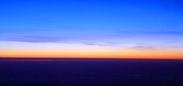 Sunrise from the plane.  If you look closely, you can see the Mississippi River in the foreground.