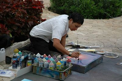 Spray paint artist.  He made paintings using spray paint and a few simple brushes.  He could finish 1 painting in about 5 minutes.