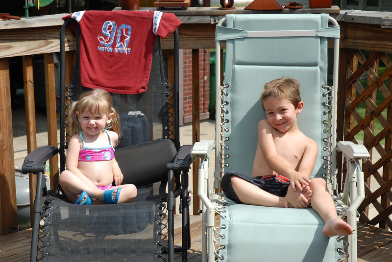 My niece Katie and my son Ryan catching some rays on the deck (I am sure they also talked about how rough their day was and worked into the conversation the inflated gas prices - ok so perhapse it was only what flavor of ice cream we were having with cake.  Yep, to be a kid again!)