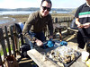Here's the birthday boy Micah, shucking oysters