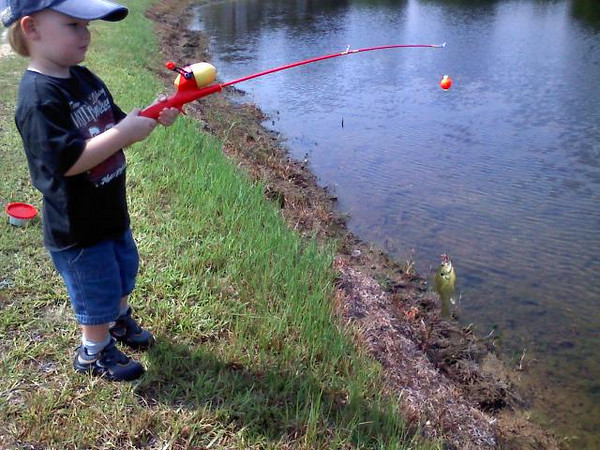 Michael's 1st Fishing Trip and his 1st fish.  July 11, 2009 Michael LOVES to go fishin' with his daddy!