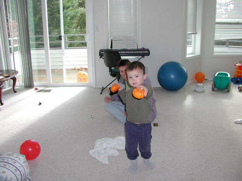 Showing off his mini pumpkins Oct '06