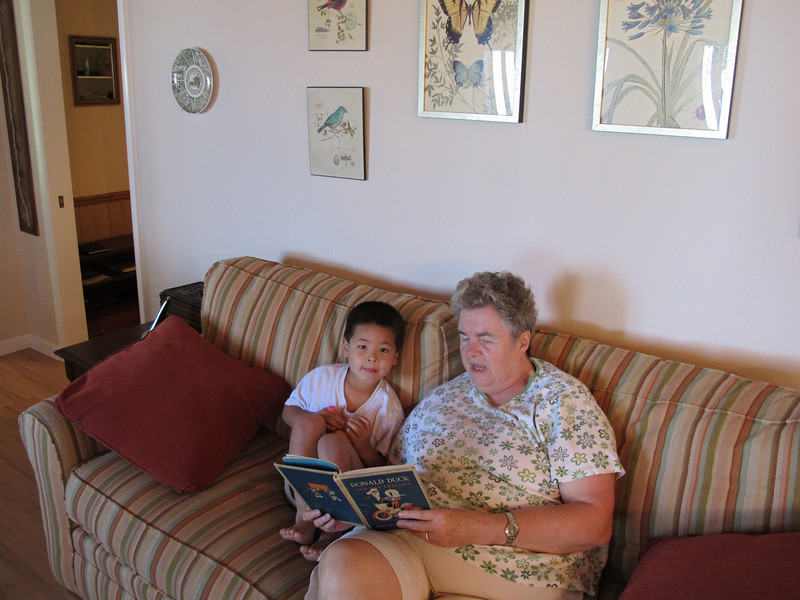 Susan reads an old cottage favorite to Alex.