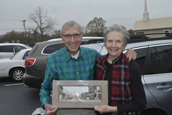 Leon and Judy with photo of Hawkinsville 1956