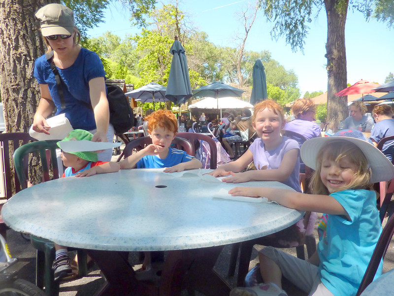 Eating lunch at Hogle Zoo.  Kids at table are Paul Larsen, Ben Anderegg, sophie Anderegg, Evelyn Larsen.  Cathy is helping everyone get set up.