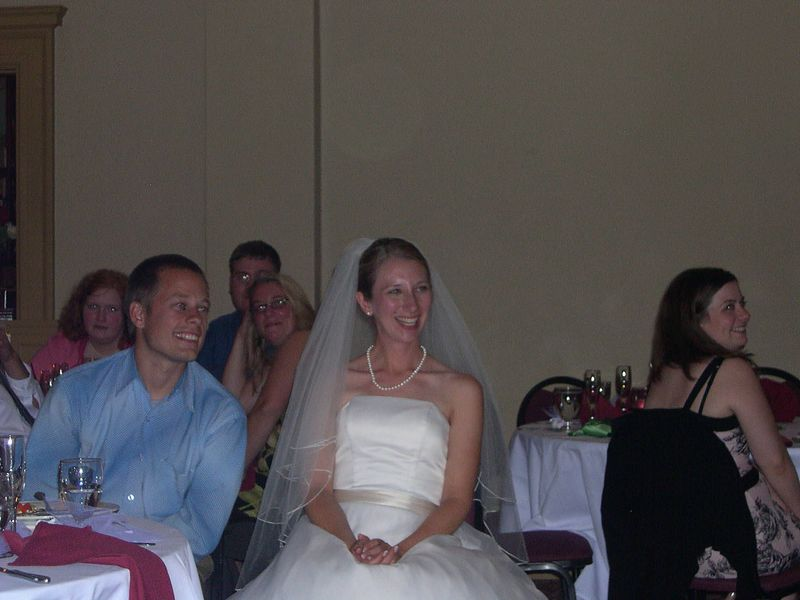 Liona, next to her brother-in-law Travis Bulman, listens to the wedding toasts