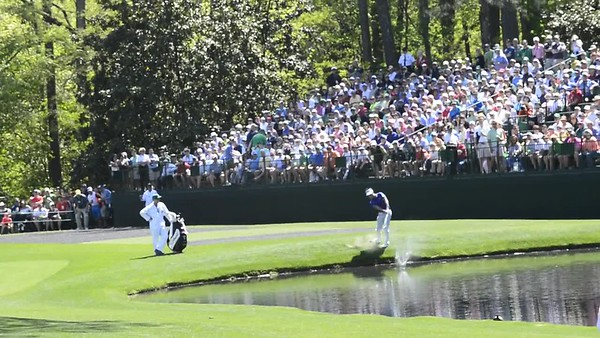 Practicing water shots on 16, bouncing the ball off the water