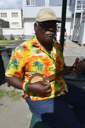 Man Playing homemade instrument