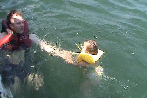 Chris , Andrew, Aidenand Emma swiing in Lake Burton