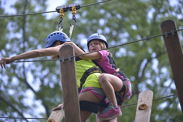 Ellis was afraid to do this obstacle by herself so she got on her mom's back to start, she got off her back and finished on her on after this photo was taken.  This part was at the first of the course, Ellis regained her composer and finished this challenge on her own.