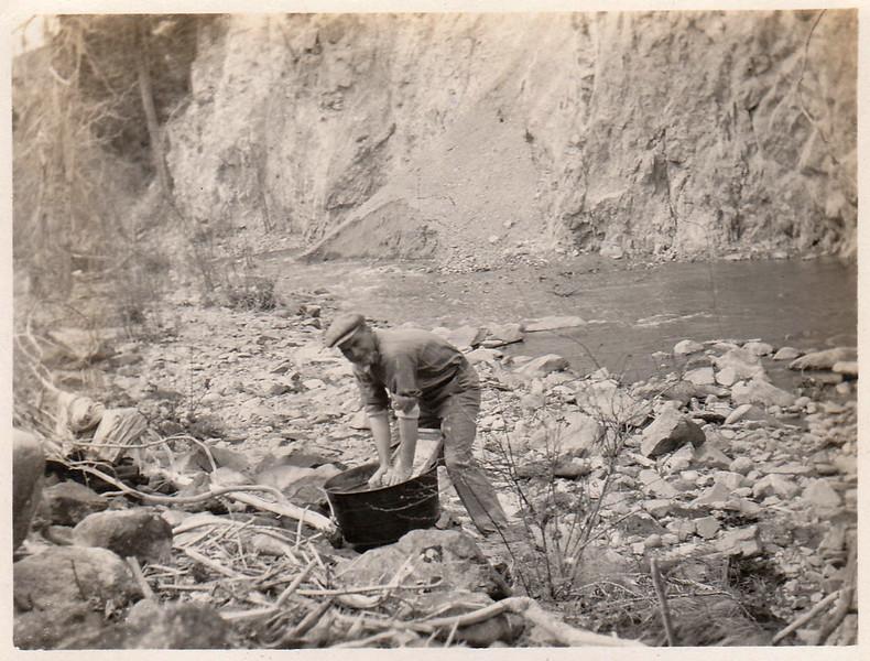 Washing clothes, tub, washboard near river