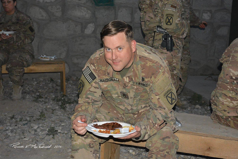 2016-05-29 Logan eating a steak in Afghanistan