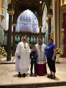 Miller and Amanda with Father Noe and Bishop Cote