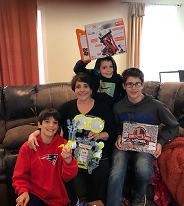 Grandma Tina with the boys and their toys.