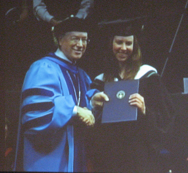 President Dr.J. Raymond gives Miriam her degree. (picure of the big screen behind the platform taken from church balcony)