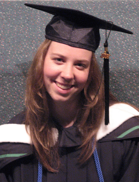 Note the black tassel on her mortarboard (the funny hat is call that) is on her left side - it changed from right to left when the degree was conferred (given by the president)