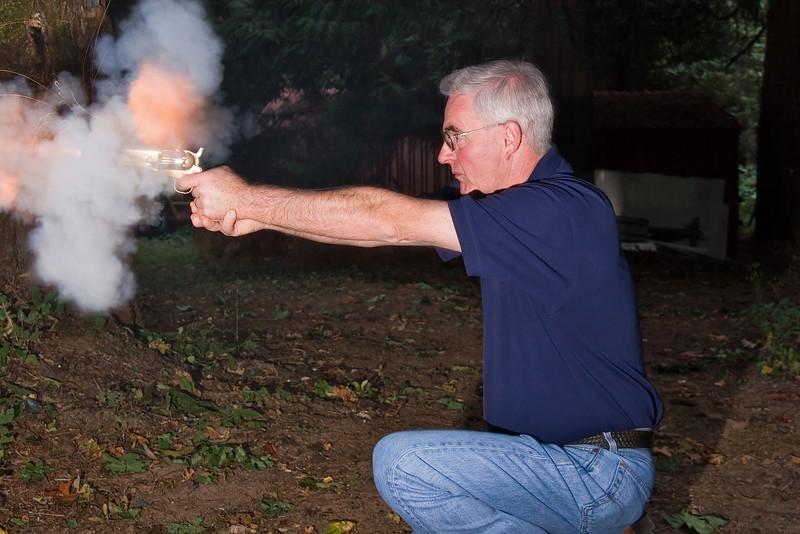 Shooting a black powder .36 caliber revolver.