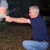 Shooting a black powder .36 caliber revolver.