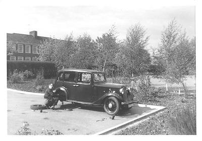 Grandad working on Mum's first car - 1937 Austin Princess.