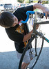 Ethan works on a bike as part of volunteer work for the Silicon Valley Bicycle Coalition.