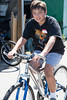 Ethan test rides a bike as part of volunteer work for the Silicon Valley Bicycle Coalition.