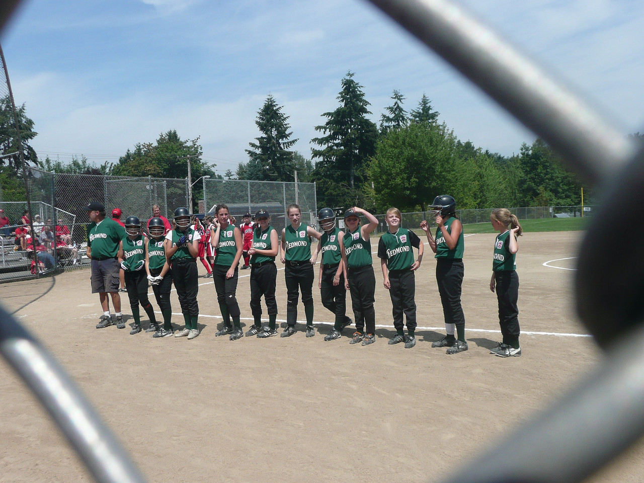 At the start of the first game, they announced each girls name and they would run out to the field.  Tons of fun!