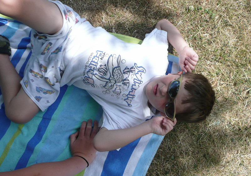 Travis looking cool in his shades in the shade...