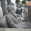 """This granite sculpture shows Davis as an old man.  The """"chair"""" next to him is vacant.  You can see that his left sleeve is empty.  He lost a hand due to an infection."""