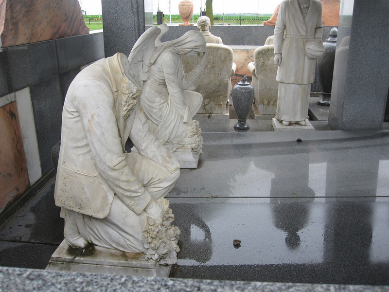 June 15, 2010.  Statues of Davis kneeling and, beyond him, a grieving angel that was carved in his wife's likeness.  There has been some vandalism to the tomb, and the statue of Davis kneeling has been decapitated.