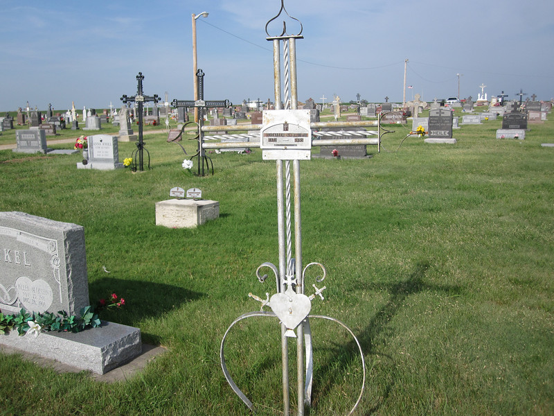 """After seeing the church, we stopped at St. Fidelis Cemetery, on the outskirts of Victoria.  We were interested in the wrought iron and cast iron crosses that were placed on so many of the graves.  This was a custom brought from Europe by the """"Volga Germans"""" who setttled western Kansas in the 1870s."""