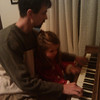 Amelia and Corey playing the piano