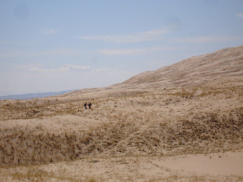 Cody and Bo nearing the steep section which leads to the high point of Kelso Dunes.