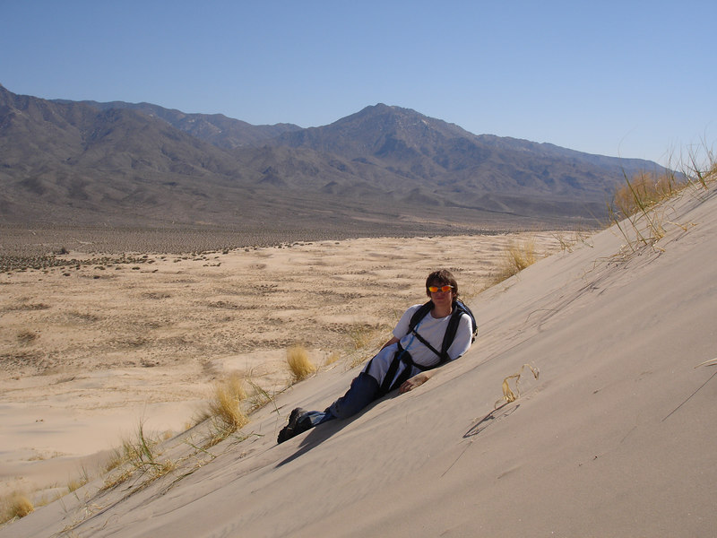Cody taking a break on the summit slope of Kelso Dunes.