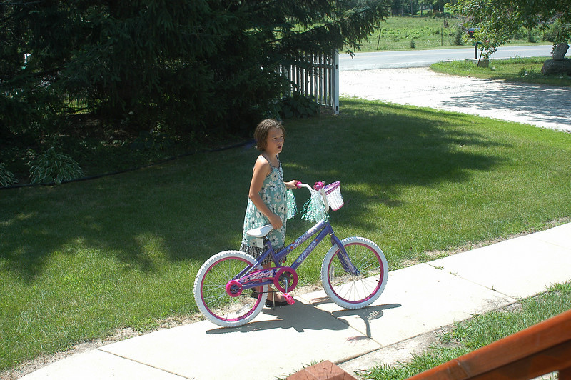 "We surpried Molly, told her to come look at Georgia's new bike. She  trudged towards Georgia to share in G's joy of a new bike, she kept thinking, ""I wish I had a bike like that."""