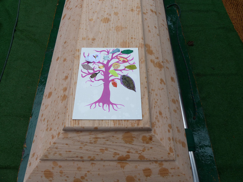Tree Of Life on my mum's casket with leaves created by her students and grandchildren