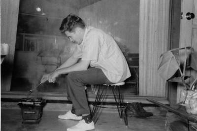 Larry Jones cooking on patio of apartment on Thomas Street, San Diego, 1961