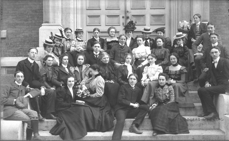 Mabel Treadwell Marean, Binghamton High School, 1897. Wife of Henry Marean, and mother of Henry Eliott, Marean. Mabel is the oe at the top with the fancy hat, just below the doorknob.