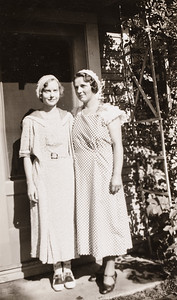 """Irene and Josephine, 8/9/34, on their way to the Chicago Worlds Fair.  Picture at Josephine's Aunt Hatties Cottage """"Rose Lodge"""", Harbert Michigan"""