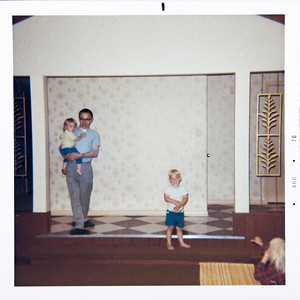 """""""Tony holding Tina.  Interior of Evelyn's new home - living room (Cathedral Ceiling), Joey and Lorie Ann"""""""