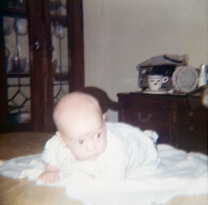 Mystery baby.  Guessing its either Susan, Dennis, Michael or myself.