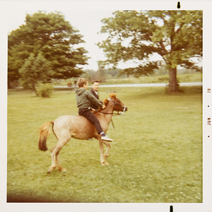 Mike on a pony at Uncle Roger's home.