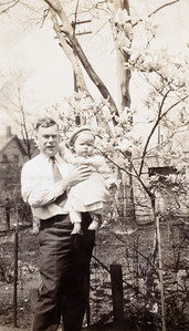 """""""Daddy + Zoe Ellen in her new Canary colored toddler's coat and hat withc Grandma Rodgers bought her.  Note, our Magnolia tree in full bloom!!"""" - 5/27/37"""