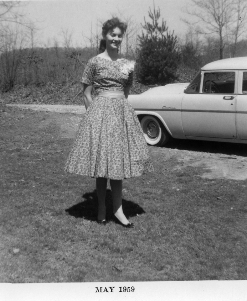 Mary Carolyn Mitchell, Easter, 1959 in the front yard of Harry Lee Burton Mitchell and Lillie Mae Fox Mitchell's home on Hall Town Road in Spruce Pine, NC. She says the dress was purple.