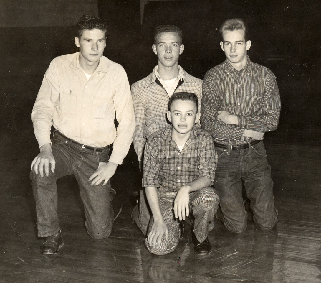 Back row: Hugh Taylor Glenn, Staples Crowder, Roger Buchanan. Front: Earl Ray Pittman. They are in the Harris High School Gym. They were football managers.