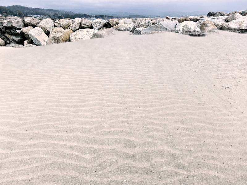 The wind made ripples in the sand.