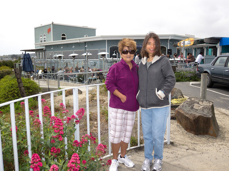 Mom and Shalimar behind the dining patio of Sam's Chowder House.