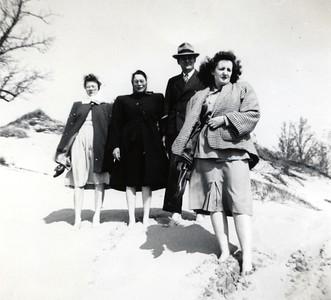 May 1, 1947 - Sand dunes around Lake Michigan. Janet, Hazel Edberg, Evald Edberg and Patricia Edberg