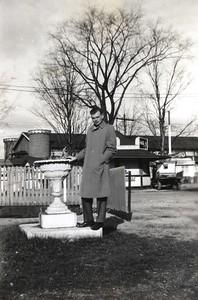 Elwin at Celeron Park leaning against flower pot - Nov 29, 1946