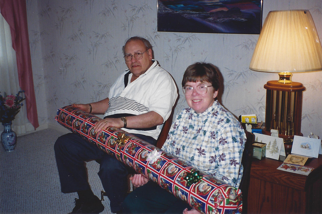 Mom and Dad at Dale's house during Christmas - I believe the gift was a kitchen rug.